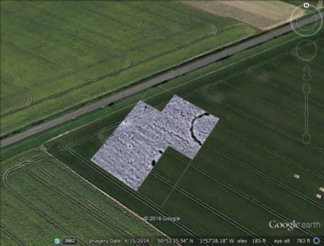 Geophysics plot of the ... overlain onto Google earth. The terminals of the flanking long barrow ditches can be seen to the left of the ring ditch.